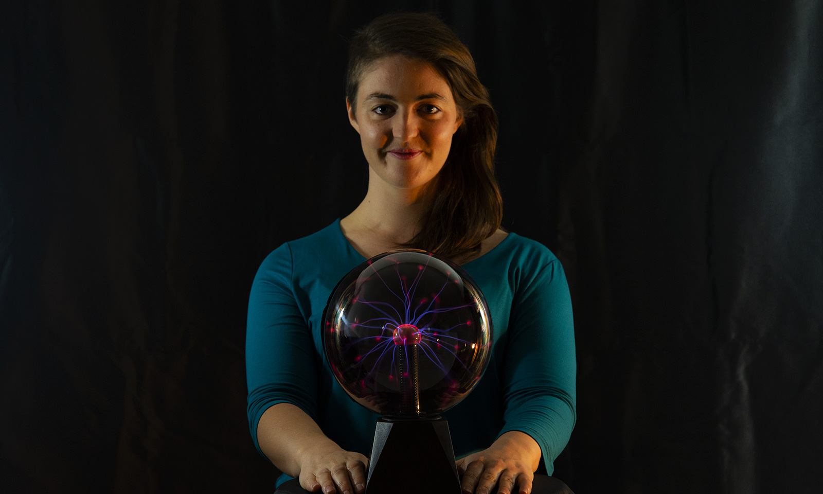 Natasha stands over a glowing plasma ball.